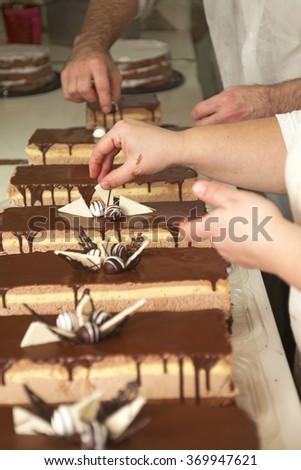 Decorating a chocolate cake, homemade work - stock photo