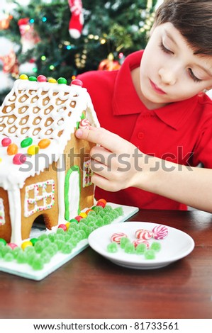 Decorating a Gingerbread House - stock photo