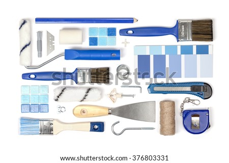 decorating and house renovation tools and accessories on white background top view. flat lay composition in blue colors - stock photo