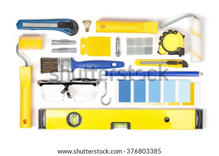 decorating and house renovation tools and accessories on white background top view. flat lay composition in yellow and blue colors - stock photo