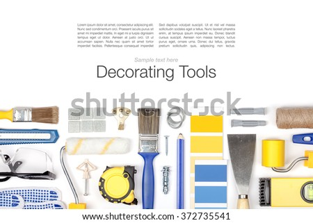 decorating and house renovation tools and accessories on white background with copy space. flat lay composition in blue and yellow colors top view