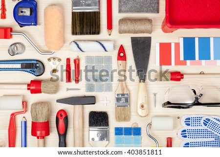 decorating and house renovation tools and accessories on wooden background top view. painter and decorator work table - stock photo