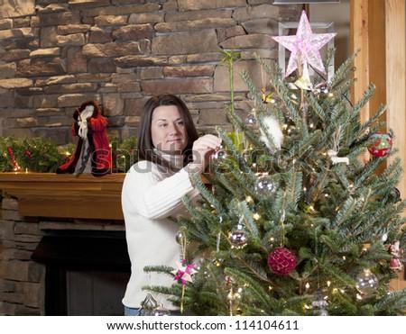 Decorating Christmas tree - stock photo