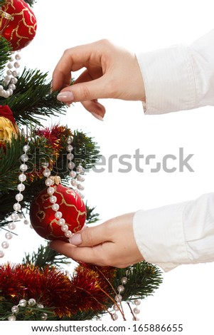 Decorating christmas tree with balls, ribbons and stuff, isolated on white background