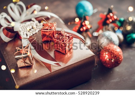 Decorating gift boxes Christmas background with on wooden board.