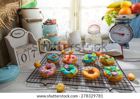 Decorating sweet donuts in the sunny kitchen