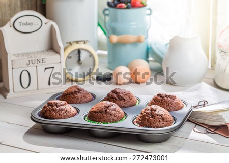 Decorating tasty muffins with caster sugar - stock photo