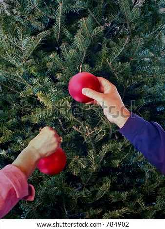 Decorating the Christmas tree - stock photo