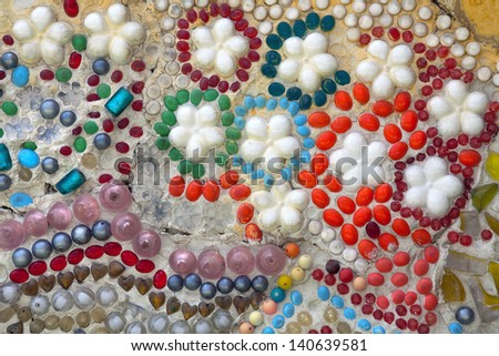 Decorating the walls with stone and beads. - stock photo