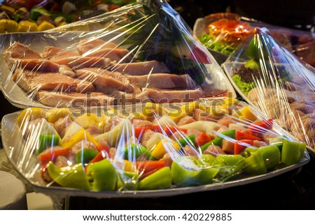 Decoration and raw foods that are wrapped with plastic wrap prepared for the wedding dinner party.