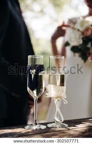 Decoration, beautiful, fun, luxury, a pair of wedding champagne glasses outdoors, close-up - stock photo