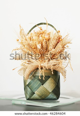 Decoration - bouquets of dried flowers and corn - stock photo