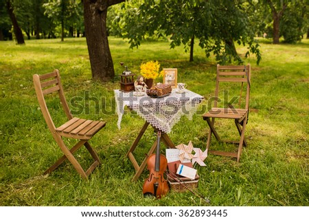 decoration in the forest, tea, romantic, the wooden table on a picnic