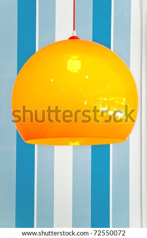 decoration lamp against blue wall - stock photo