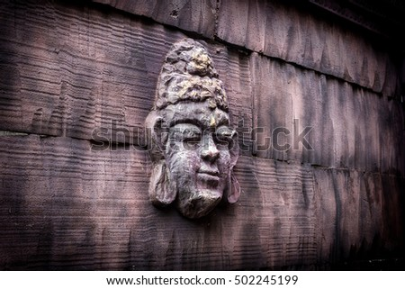 decoration of a buddha face in a vintage wall