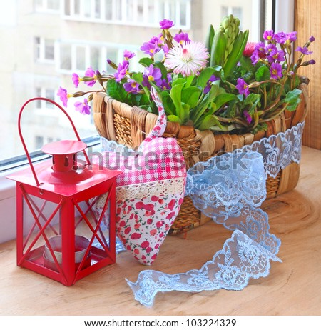 Decoration of balcony hyacinths bellis and primrose Spring flowers on a balcony - stock photo