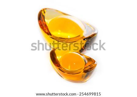 Decoration of chinese crystal gold ingots isolated on white background - stock photo