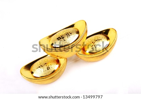 Decoration of chinese gold ingots in isolated white background - stock photo