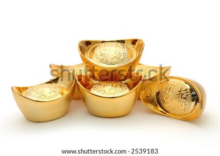 Decoration of chinese gold ingots in isolated white background - stock photo
