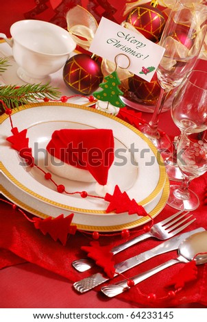 decoration of christmas table in red and white colors - stock photo