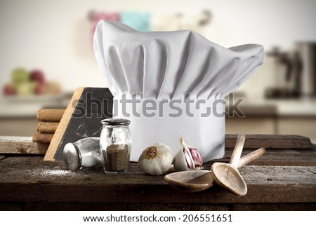 decoration of cook hat spoons books and kitchen