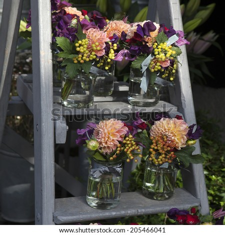 decoration of dining table. bouquet of dahlia in vase of glass. - stock photo