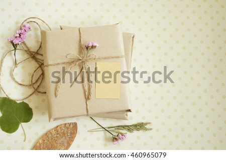 decoration of  gift box (package) with blank  card on fabric  background.