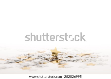 Decoration of golden confetti stars on white background