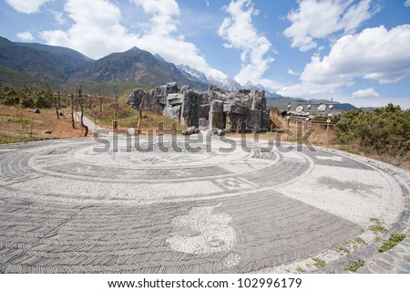 Decoration of ground mosaic in Dongba God's Garden , Lijiang city - Yunnan province China. - stock photo