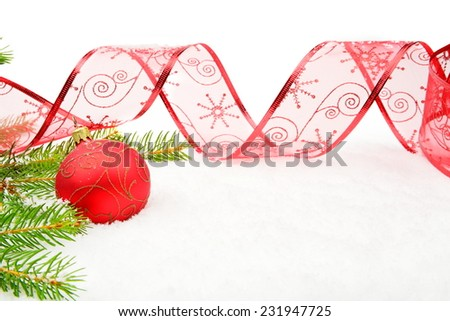 Decoration of red christmas on snow, christmas tree branch on whi - stock photo