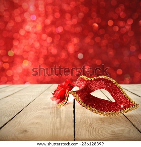 decoration of red mask and red space of carnival lights  - stock photo