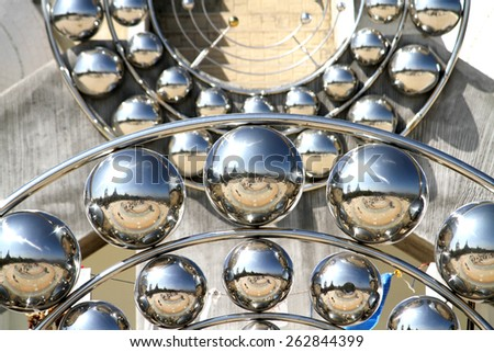 Decoration of stainless steel ball on the wall in the temple, Thailand - stock photo