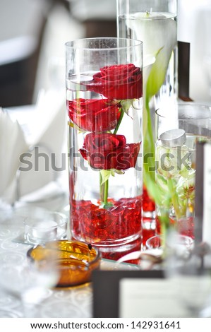 decoration of summer garden table. Roses in vase on white table - stock photo