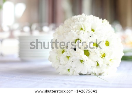 Decoration of the dining table for wedding reception, bouquet of daisies - stock photo