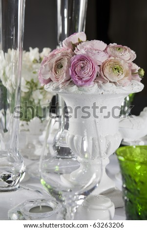 decoration of wedding table. Pink ranunculus (persian buttercup) in vase - stock photo