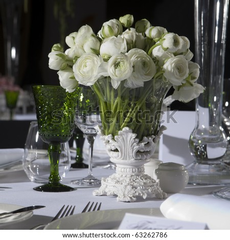 decoration of wedding table. White ranunculus (persian buttercup) in vase - stock photo