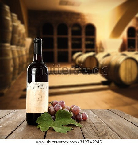 decoration of wine in interior of brown colors and barrels  - stock photo