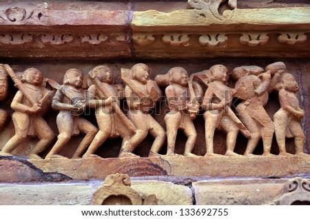 Decoration on Lakshmana Temple wall, Khajuraho, built between AD 930-950 - stock photo