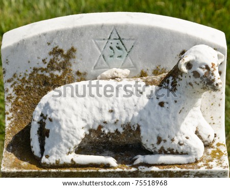 Decoration on old grunge marble tombstone. Jewish cemetery in California - stock photo