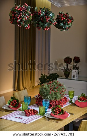 decoration on the table in the house of colored glassware and colorful fabrics - stock photo