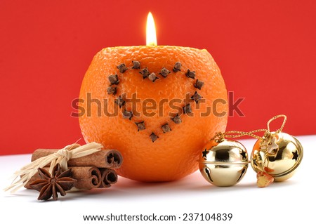 Decorations Christmas and oranges candle - stock photo