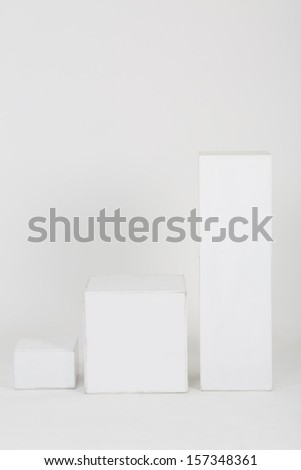 Decorations for the studio in the form of three pedestals of different heights - stock photo