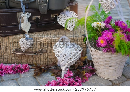 decorations of hearts and suitcases with flowers. - stock photo