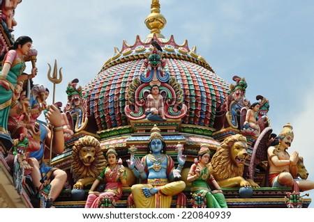 Decorations of the Hindu temple Sri Mariamman near China Town Singapore - stock photo