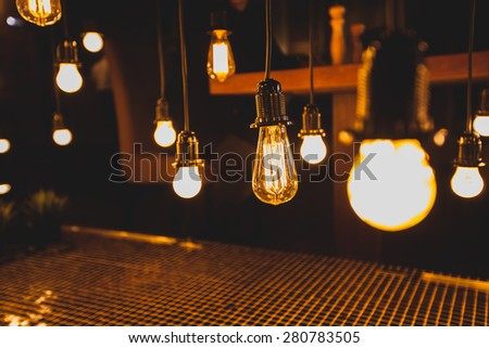 Decorative antique edison style light bulbs against brick wall background. - stock photo