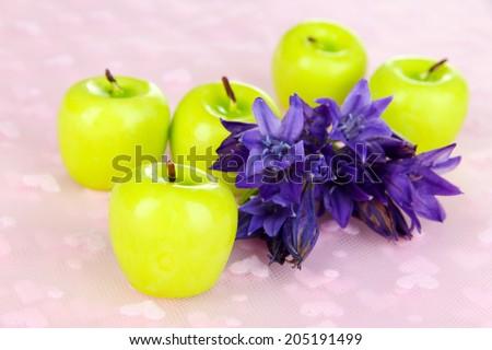 Decorative aroma candles on fabric background - stock photo