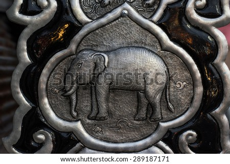 Decorative Art of Lanna at Chiangmai Thailand. Engraving of the silver value. - stock photo