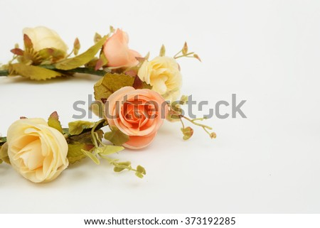 Decorative artificial rose on white background