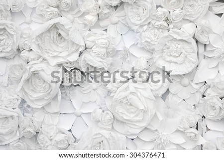 decorative background from white paper flowers of paper-mache  - stock photo