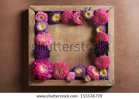 Decorative background with flowers border, rustic style - stock photo